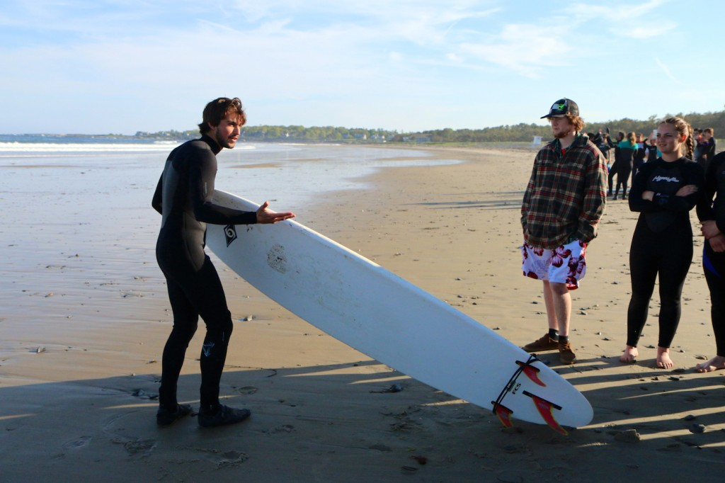 Sawyer teaches a surf lesson