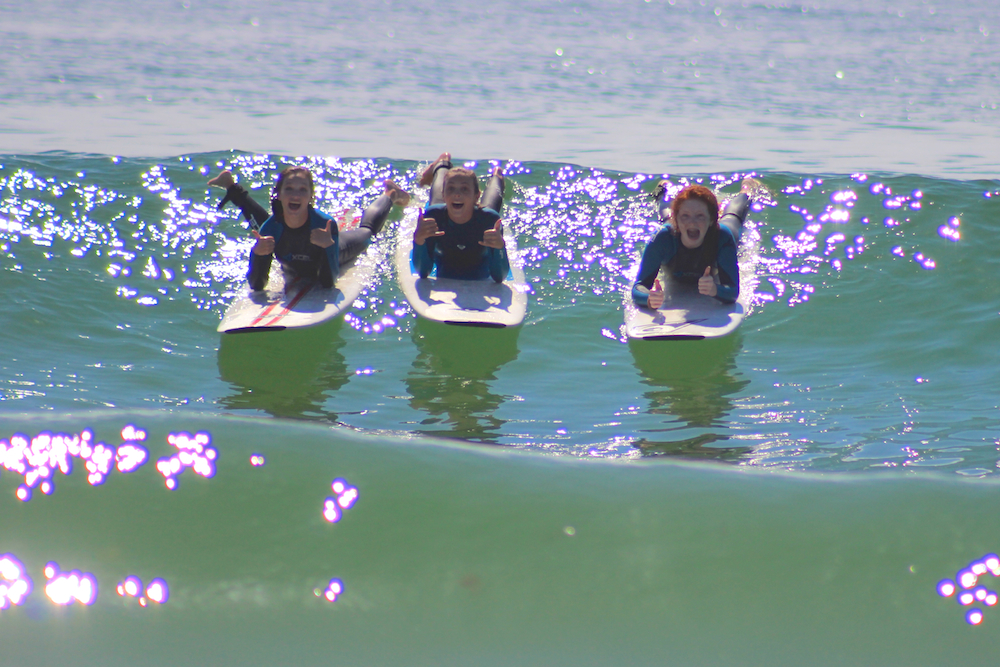 Surf campers enjoying perfect waves and weather